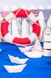 Maritime décor paper boats, shells Stock Images