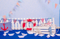 Maritime décor paper boats, shells Royalty Free Stock Image