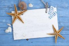 Maritime Decoration with shells, starfish, sailing ship, fishing net on blue drift wood. Maritime Decoration with shells, starfish, sailing ship, fishing net on stock photography