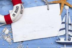 Maritime Decoration with shells, starfish, sailing ship, fishing net on blue drift wood. Maritime Decoration with shells, starfish, sailing ship, fishing net on royalty free stock photos