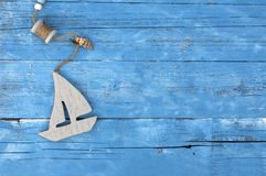 Maritime Decoration with shells, starfish, sailing ship, fishing net on blue drift wood. Maritime Decoration with shells, starfish, sailing ship, fishing net on royalty free stock photography