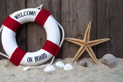 Maritime Decoration with shells, starfish, sailing ship, fishing net on blue drift wood. Maritime Decoration with shells, starfish, sailing ship, fishing net on stock image