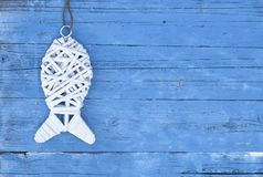 Maritime Decoration with shells, starfish, sailing ship, fishing net on blue drift wood. Maritime Decoration with shells, starfish, sailing ship, fishing net on stock photo