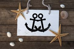Maritime Decoration with shells, starfish, sailing ship, fishing net on blue drift wood. Maritime Decoration with shells, starfish, sailing ship, fishing net on stock photos