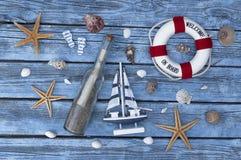 Maritime Decoration with shells, starfish, sailing ship, fishing net on blue drift wood. Maritime Decoration with shells, starfish, sailing ship, fishing net on royalty free stock image