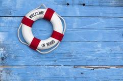Maritime Decoration with shells, starfish, sailing ship, fishing net on blue drift wood royalty free stock photo