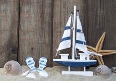 Maritime Decoration with shells, starfish, sailing ship, fishing net on blue drift wood. Maritime Decoration with shells, starfish, sailing ship, fishing net on royalty free stock images
