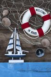 Maritime Decoration with shells, starfish, sailing ship, fishing net on blue drift wood stock photos