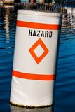 Maritime Diamond Hazard Warning Buoy. Diamond hazard warning buoy in body of water with bird spikes royalty free stock images