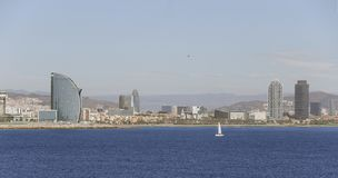 Barcelona view from the seaport wide view. Maritime facade of the city of Barcelona with barceloneta beach on first term and some city skycrapers behind royalty free stock image