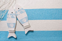 Maritime fish background. Maritime background or decoration with fish in turquoise Royalty Free Stock Photography