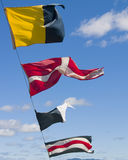 Maritime Flags. Waving against a blue sky Stock Photography