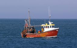 Maritime industry. Small lobster or crab boat out on the ocean on sunny day Stock Photo