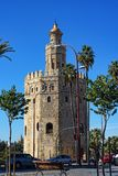 The Maritime Museum in the Golden Tower on the banks of the River Guadalquivir in Seville Spain. The Torre del Oro or the Tower of Gold is a dodecagonal royalty free stock image