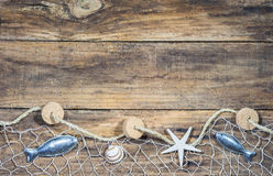 Maritime Nautical Decoration With Fishing Net On Brown Wood