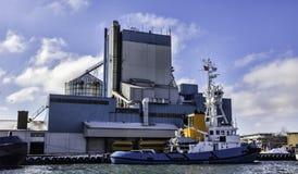 Maritime pilot ship. Aabenraa harbor in Denmark. Maritime pilot ship and silos. Aabenraa harbor in Denmark Stock Image