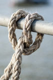 Maritime ropes tied up on a quayside Royalty Free Stock Images
