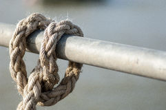 Maritime ropes tied up on a quayside Stock Images