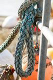 Maritime ropes tied up on a quayside Stock Photos