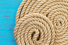 Maritime theme background of wound up rope Royalty Free Stock Photo