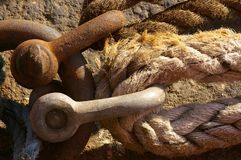 Maritime Tie-ups 01. Ropes tieing up a ship to a mooring against the dock wall in Liverpool Royalty Free Stock Photo