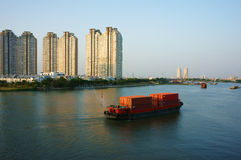 Maritime transport by loading container on river Royalty Free Stock Photography