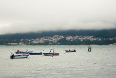 Mysterious maritime town, boats and fog royalty free stock image