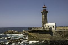 Signal lighthouse at the entrance of the Douro river in Oporto in Portugal stock photography
