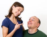 Marito che elemosina, moglie non sure. Immagine Stock Libera da Diritti