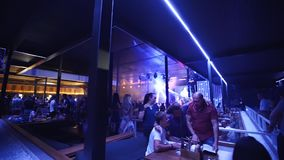 Mariupol, Ukraine - 15 June 2019. People are dancing in Barbaris night club lit by show lights. Men and women partying stock video