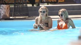 Mariupol, Ukraine - 15 June 2019. Swimming pool area on sunny day at Barbaris Beach Club weekend party. Women chill at stock footage