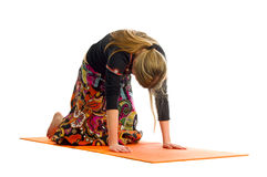 Marjariasana , a position in Yoga, is also called cat tilt pose Stock Photo