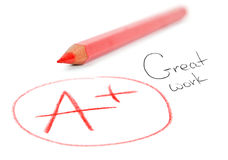 Mark A+ με το κόκκινο μολύβι. Μεγάλη εργασία στοκ εικόνες