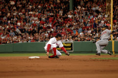 Mark Bellhorn, Boston Red Sox. Boston Red Sox 2B Mark Bellhorn waits for Indians catcher Victor Martinez to reach second base so he can put a tag on him. (Image Stock Photos