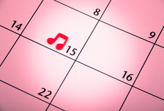 Mark on the calendar with music simbol Royalty Free Stock Photo