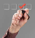 Mark the check boxes. Hand with pen mark the check boxes Stock Image