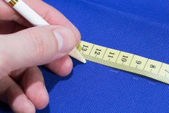 Mark cloth with special white pen. Before making the cut Royalty Free Stock Images