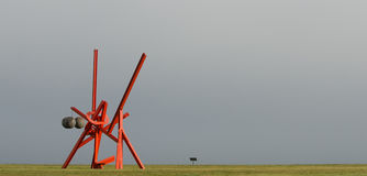 Mark di Suvero at Crissey Field. Mark di Suvero's sculpture Figolu at Crissey Field in the Presidio of San Francisco. The sculpture is part of an exhibition royalty free stock photo