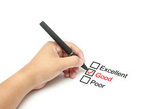 Mark Good on performance evaluation. Businessman hand with pen on white background Royalty Free Stock Photo