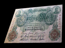 50 Mark - Historical banknote. 50 Mark. Historical note at the beginning of the 20th century. Notes of Germany. Banknote on a black background stock photography