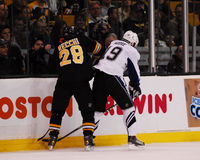 Mark Recchi goes against Dominic Moore. Royalty Free Stock Photo