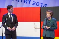 Mark Rutte e Angela Merkel que abrem Hanover Messe Fotografia de Stock