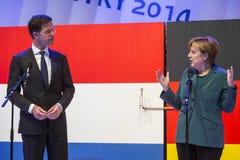 Mark Rutte e Angela Merkel que abrem Hanover Messe Foto de Stock