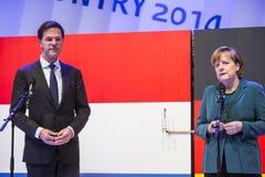 Mark Rutte e Angela Merkel que abrem Hanover Messe Imagens de Stock Royalty Free