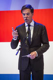 Mark Rutte holding a speech in front of the Dutch flag Stock Image
