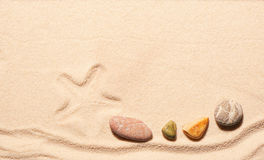 Mark of starfish and sea stones on sand Royalty Free Stock Photo