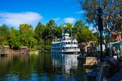 Mark Twain Disneyland Steamboat Replica. Disneyland has thousands of visitors each day. In Frontierland one of the more popular rides is the steamboat replica Stock Image