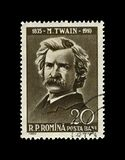 Mark Twain, famous adventures writer, Romania, circa 1960,. Mark Twain 1835-1910, famous adventures writer, canceled postal stamp of Romania isolated on black stock photos