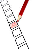 Marked check box. With a red pencil Stock Images
