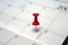 Marked date. Calendar with a pin to mark a date Stock Photo